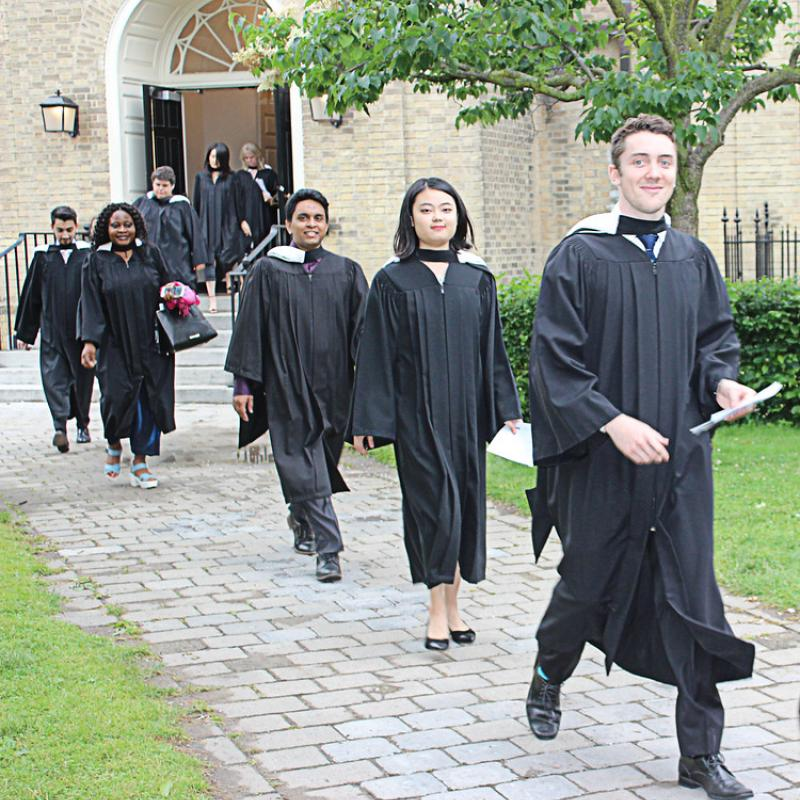 Convocating students on their way to Convocation Hall