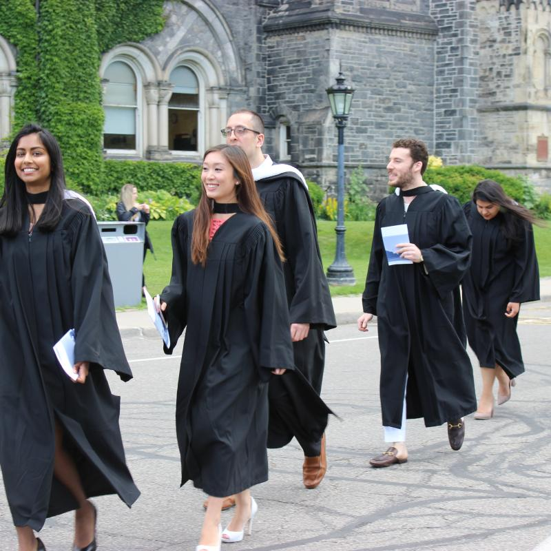 Woodsworth graduands walking towards Convocation Hall