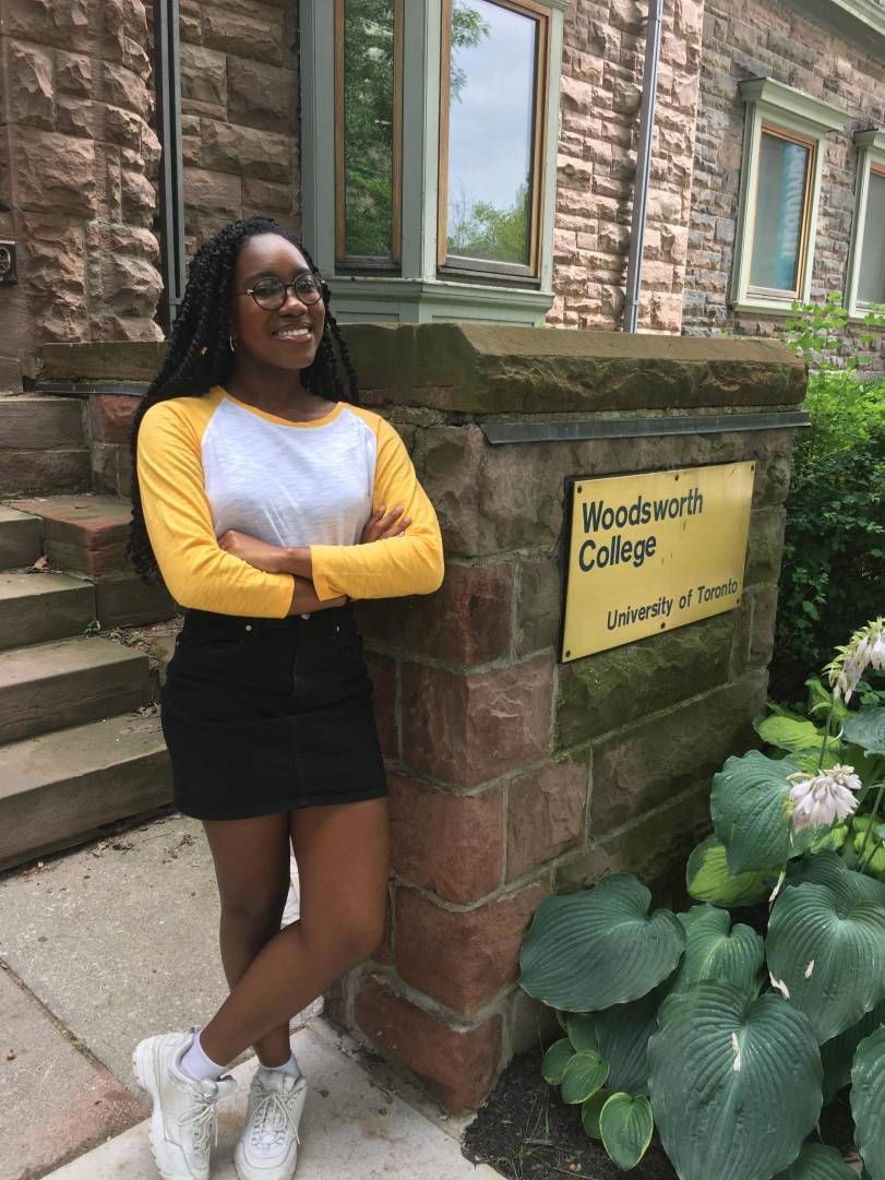 Former Woodsworth One student Abena Somiah poses on the front steps at Woodsworth College.