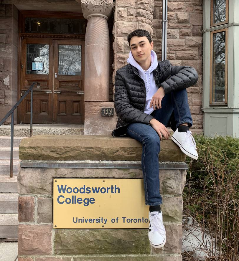 Former Woodsworth One student George Moshenski-Dubov poses on the front steps at Woodsworth College.